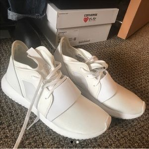 White adidas tubular sneakers